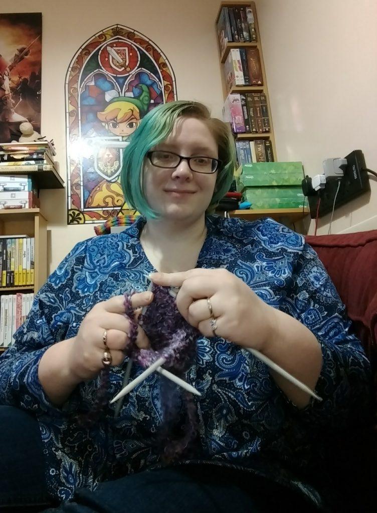 Emily knitting a mitten.