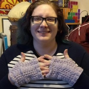 Emily wearing the Swift and Simple Lace Fingerless Mitts.